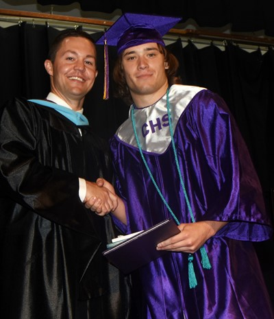 CHS Principal Weston Jones congratulates Tristan Johnson.