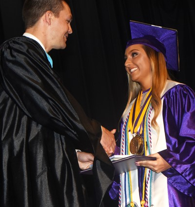 CHS Principal Weston Jones congratulates Reagan Knight.