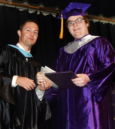 CHS Principal Weston Jones congratulates Devin Lori.