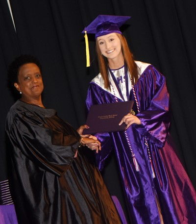 Campbellsville Board of Education member Barkley Taylor gives Samantha Mason her diploma.