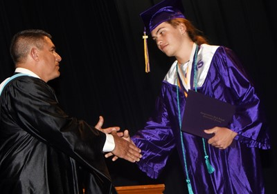 Campbellsville Independent Schools Superintendent Kirby Smith congratulates Treyce Mattingly.