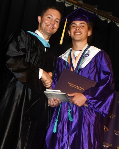 CHS Principal Weston Jones congratulates Treyce Mattingly.