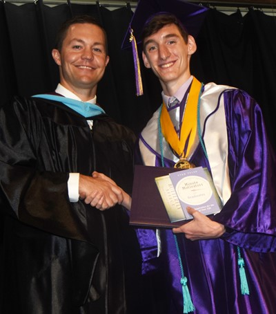 CHS Principal Weston Jones congratulates Ian McAninch.