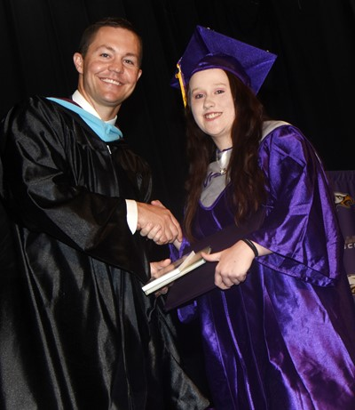 CHS Principal Weston Jones congratulates Gracie Miller.