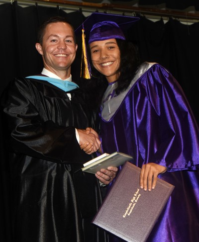 CHS Principal Weston Jones congratulates Kalisha Murphy.