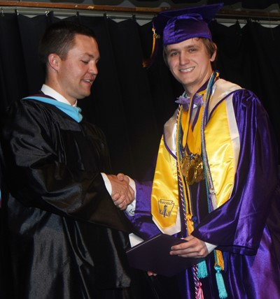 CHS Principal Weston Jones congratulates Myles Murrell.