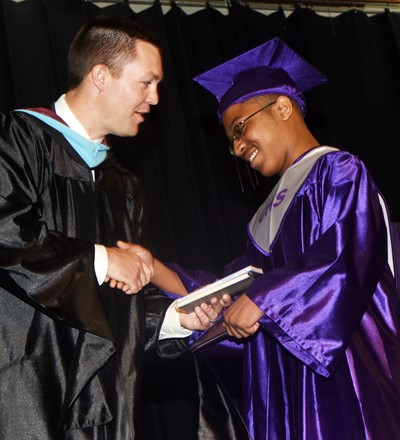 CHS Principal Weston Jones gives Travis Nash his diploma.