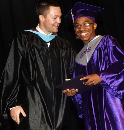 CHS Principal Weston Jones congratulates Travis Nash.