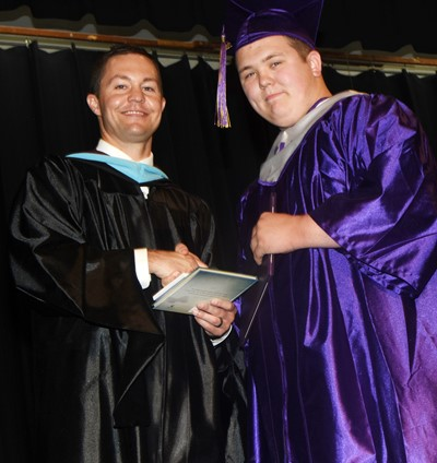 CHS Principal Weston Jones congratulates Jorden Perkins.