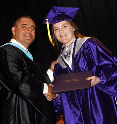Campbellsville Independent Schools Superintendent Kirby Smith congratulates Cassie Pipes.
