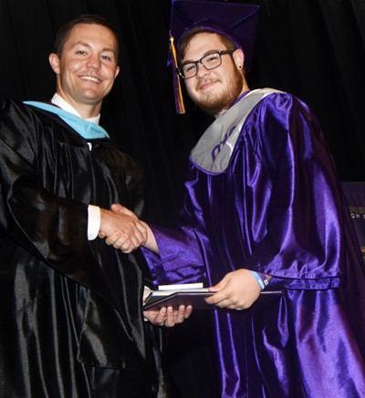 CHS Principal Weston Jones congratulates Kyler Rakes.