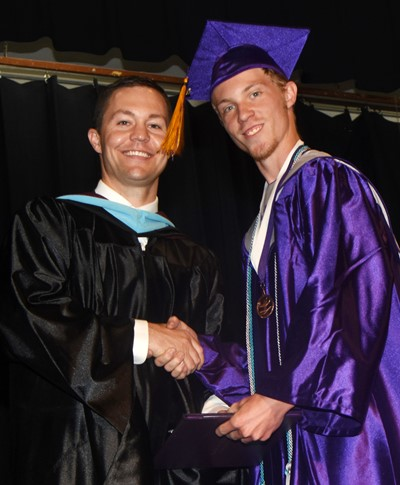 CHS Principal Weston Jones congratulates Payton Reynolds.