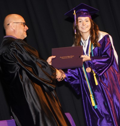 Campbellsville Board of Education member Mitch Overstreet gives Christa Riggs her diploma.