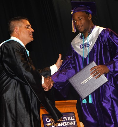 Campbellsville Independent Schools Superintendent Kirby Smith congratulates Taj Sanders.