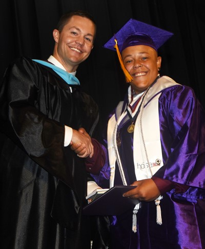 CHS Principal Weston Jones congratulates Dee Simpson.
