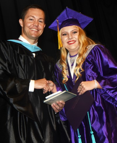 CHS Principal Weston Jones congratulates Hayley Stapleton.