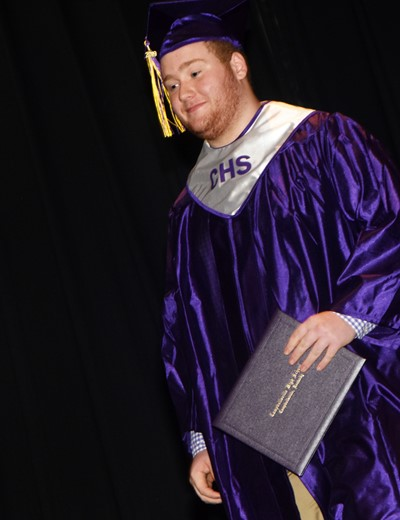 CHS senior Spencer Swafford walks across the stage as he receives his diploma.