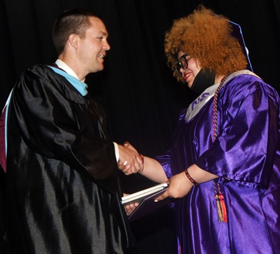 CHS Principal Weston Jones congratulates Jay Tucker.