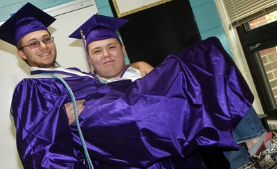 CHS senior Jorden Perkins holds classmate Keidlan Boils as they prepare to graduate.