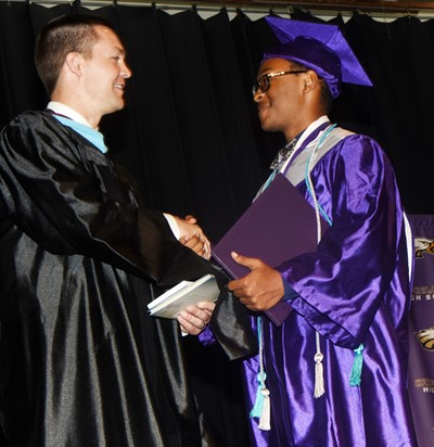 CHS Principal Weston Jones congratulates Daesean Van Cleave.