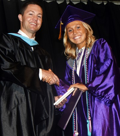 CHS Principal Weston Jones congratulates Tatem Wiseman.