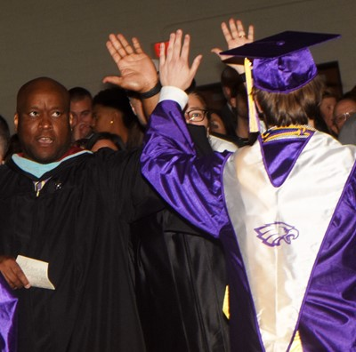 CHS teacher Anthony Epps high-fives Myles Murrell as he walks out of the auditorium.