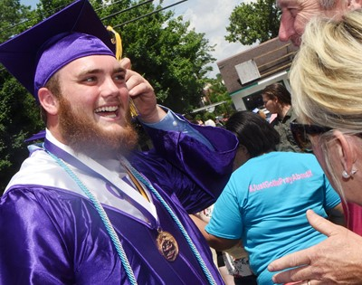 CHS senior Lane Bottoms talks with family and friends after graduation.