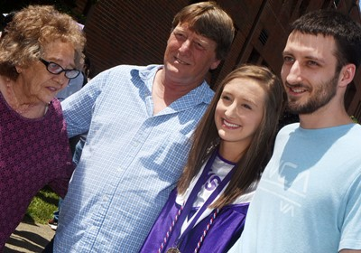 CHS senior Samantha Mason takes photos with family members.
