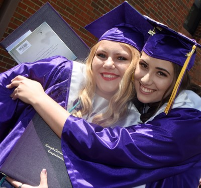 CHS seniors Hayley Stapleton, at left, and Elizabeth Sullivan smile together.