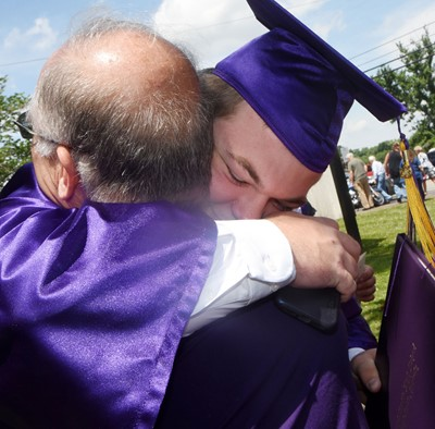 CHS senior Josh Dooley hugs his father, Ronnie.