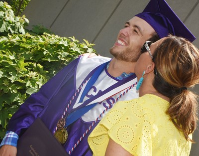 CHS senior Layton Hord receives a kiss on the cheek from his mother, Farrah.