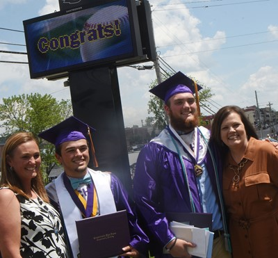 CHS seniors Ryan Kearney, at left, and Lane Bottoms pose for a photo with their mothers. At left is Bottoms's mother Kecia and at right is Kearney's mother Lisa.