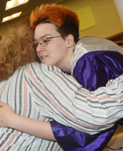 CHS teacher Tammy Wilson hugs senior Chloe Decker.