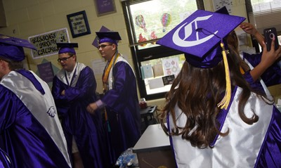 CHS senior Christa Riggs and her classmates talk before their graduation ceremony.