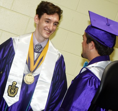 CHS seniors Ian McAninch, at left, and Ryan Kearney talk before their graduation ceremony.