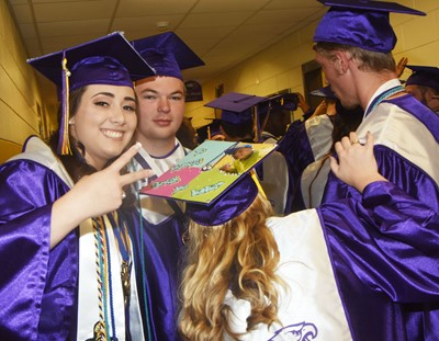 CHS seniors Elizabeth Sullivan and Josh Dooley smile before the graduation ceremony begins.