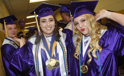 CHS seniors, from left, Josh Dooley, Elizabeth Sullivan and Hayley Stapleton smile before the graduation ceremony begins.