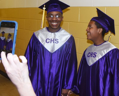 CHS seniors Travis Nash, at left, and Chris Moran smile before the graduation ceremony.