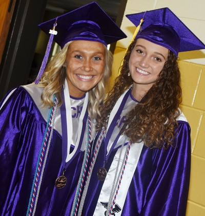 CHS seniors Tatem Wiseman and Salena Ritchie smile before the graduation ceremony.