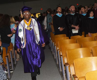 CHS senior Jeremiah Jackson walks in as graduation gets underway.