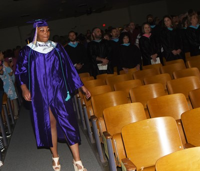 CHS senior Malaya Hoskins walks in as graduation gets underway.