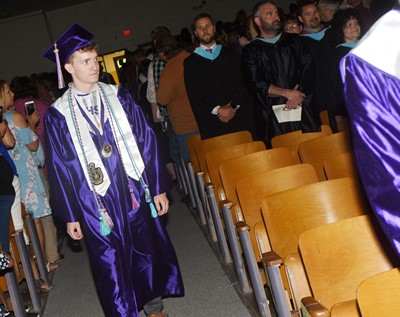 CHS senior Jackson Hinton walks in as graduation gets underway.