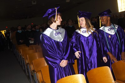 From left, CHS seniors Jason Agee, Hailey Armstrong and Ceondre Barnett stand as the graduation ceremony begins.