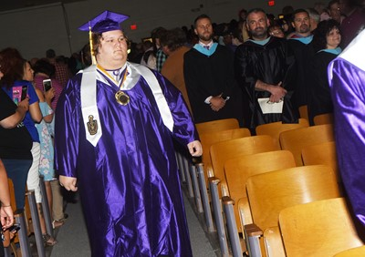 CHS senior Randy Harris walks in as graduation gets underway.