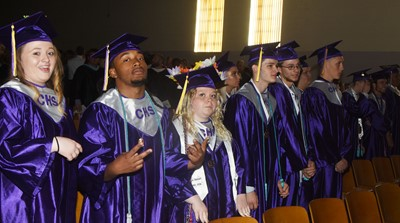 From left, CHS seniors Hailey Armstrong, Ceondre Barnett and Jessie Bennett stand with their classmates.