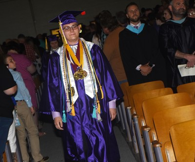 CHS senior Brandon Greer walks in as graduation gets underway.