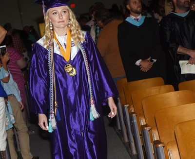 CHS senior Abbie Dicken walks in as graduation gets underway.