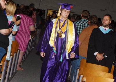 CHS senior Myles Murrell walks in as graduation gets underway.