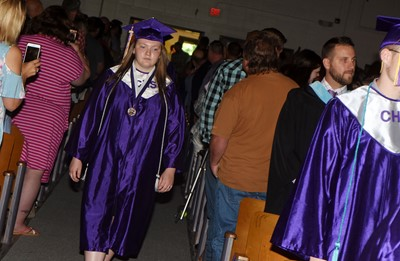 CHS senior Katelyn Walker walks in as graduation gets underway.