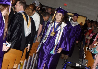 CHS senior Elizabeth Sullivan walks in as graduation gets underway.